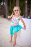 Portrait little adorable girl on a tropical white Royalty Free Stock Images