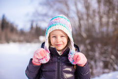 Portrait of little adorable girl in winter hat at Stock Images