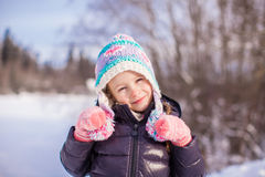 Portrait of little adorable girl in winter hat at Royalty Free Stock Photos