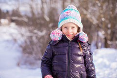 Portrait of little adorable girl in winter hat at Stock Photo