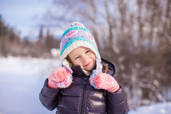 Portrait of little adorable girl in winter hat at Royalty Free Stock Photography