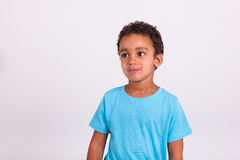 Portrait of a little African American boy smiling. Portrait of a cute little African American boy smiling Royalty Free Stock Photo