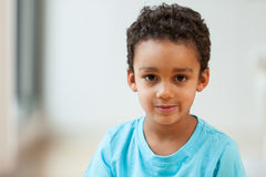 Portrait of a little African American boy smiling. Portrait of a cute little African American boy smiling Royalty Free Stock Photos