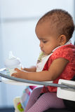 Portrait of little African American little girl holding her milk Royalty Free Stock Image