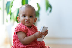 Portrait of little African American little girl holding a mobile Stock Photography