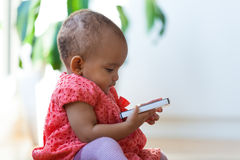 Portrait of little African American little girl holding a mobile Royalty Free Stock Photo
