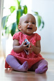Portrait of little African American little girl holding a mobile Royalty Free Stock Photos