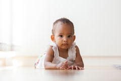 Portrait of little African American little girl lying down on th Royalty Free Stock Images