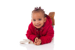 Portrait of little African American little girl lying down on th Stock Image