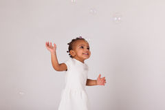 Portrait of little African American little girl playing with soa Royalty Free Stock Photos