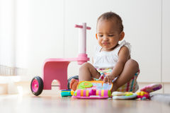Portrait of little African American little girl sitting on the f Stock Photos
