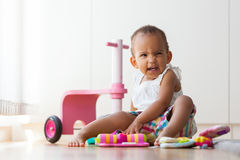 Portrait of little African American little girl sitting on the f Royalty Free Stock Image