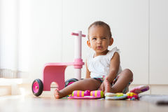 Portrait of little African American little girl sitting on the f Stock Photography