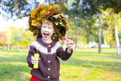Portrait of little amusing girl outdoors Stock Photos