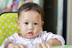 Portrait of little Asian baby boy with snot runny nose. Close-up shot.  royalty free stock photography