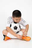 Portrait of Little asian boy with cocker ball in sport unifrom Royalty Free Stock Photo