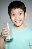 Portrait of Little asian boy drinking a glass of milk Royalty Free Stock Photo