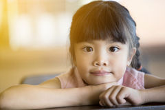 Portrait of a little Asian child girl looking at camera Royalty Free Stock Photography
