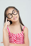 Portrait of little Asian child thinking action Royalty Free Stock Photography