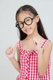 Portrait of little Asian child thinking action Stock Photo