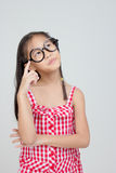 Portrait of little Asian child thinking action Stock Image