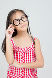 Portrait of little Asian child thinking action Royalty Free Stock Photos