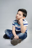 Portrait of little asian cute boy acting think about that . Stock Photos