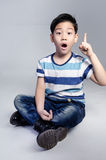 Portrait of little asian cute boy acting think about that . Royalty Free Stock Images