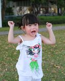 Portrait little Asian girl crying in park outdoor stock photography