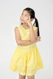 Portrait of Little asian girl is think about that Royalty Free Stock Photography