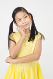Portrait of Little asian girl think about that Royalty Free Stock Photography