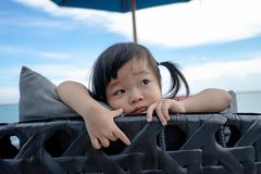 Portrait of little asian girl who thinking.  royalty free stock photo