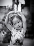 Portrait of a little Asian kid girl  with arms like heart Stock Photography