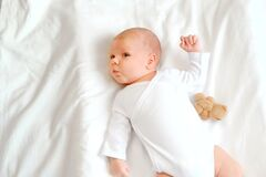 Free Portrait Little Baby Boy 1 Months Old In White Clothes Lying On His Back In His Crib. Concept Of Health And Children. Selective Stock Photography - 191291142