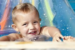 Portrait of little baby boy swimming in the Royalty Free Stock Photo