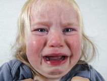 Portrait  little baby crying tears emotionally. Portrait of a little baby crying tears emotionally Royalty Free Stock Photo