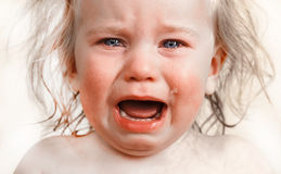 Portrait  little baby crying tears emotionally Stock Image