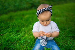 Portrait of a little baby in a denim clothes Stock Photography