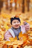 Portrait of little baby girl in the autumn park Royalty Free Stock Images