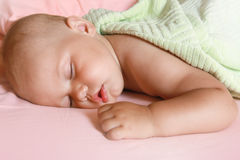 Portrait of Little baby sleeping in the bed Stock Photography