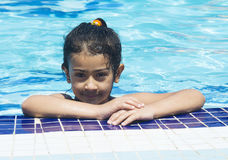 Portrait of little baby swimming in swimming pool Royalty Free Stock Photography