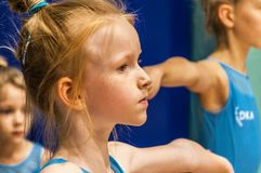 Portrait of little gymnast in gym royalty free stock photo