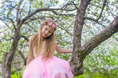 Portrait of little beautiful girl in blossoming Stock Images