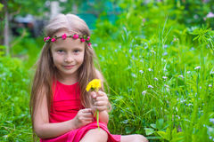 Portrait of little beautiful girl with flowers in Stock Images