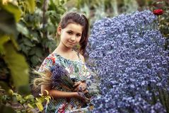 Outdoor portrait of a beautiful girl with flowers stock image