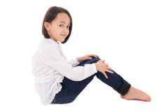 Portrait of little beautiful girl sitting isolated on white Royalty Free Stock Image