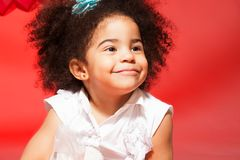 Portrait of little black curly haired girl Royalty Free Stock Photos