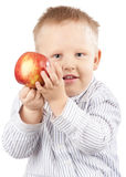 Portrait of little blond boy with apple Stock Photo