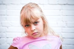 Portrait of a little blond girl Stock Images