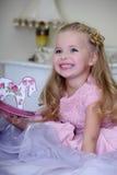 Portrait of a little blond girl Stock Photos